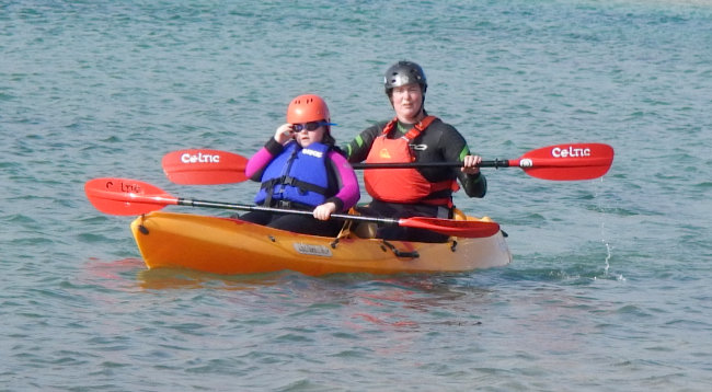 Access lizard adventure instrutor kayaking with client