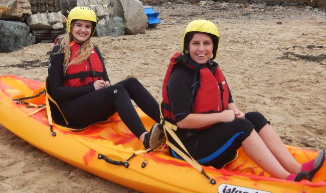 Access Lizard adventure clients sitting in a kayak